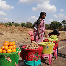 Photo of a woman at fruit stand - SmartSimple's dedicated technical community support