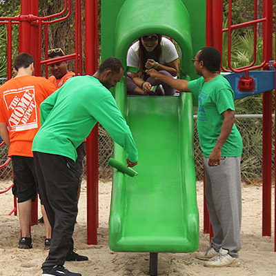 Photo of volunteers at playground - The SmartSimple user portals allow schools to ask for exactly what they need, much like a library