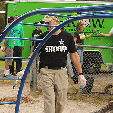Photo of police volunteering - GROW found value in tracking their progress and were able to report and present their accomplishments to new schools and counties
