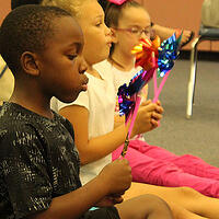 Photo of children playing - By simplifying their administrative processes, GROW Central Florida can focus on their mission