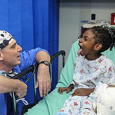 Photo of surgeon with patient - SmartSimple offers Premium Support Services