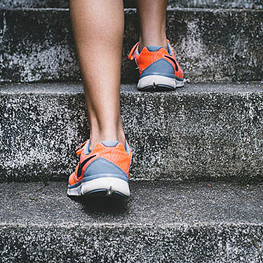 Photo of jogger running up stairs - Premium Support Services was created in response to frequent requests from clients looking for an enhanced service option.