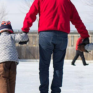Photo of family skating - SmartSimple is making the City of London's work supporting organizations so much easier
