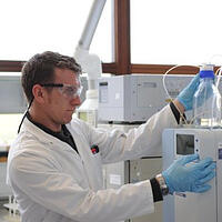 Photo of lab technician - Marine Institute now has immediate access to a massive amount of data at the click of a button