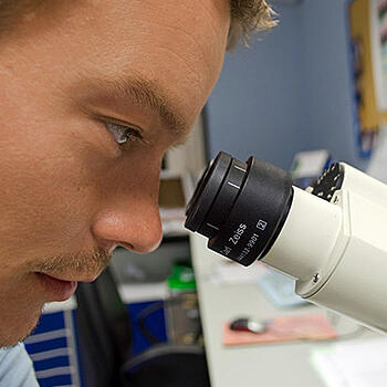 Photo of a lab techician - Massachusetts Life Sciences Center and SmartSimple