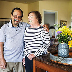 Photo of a couple at home - SmartSimple stores every grant and scholarship securely in one place