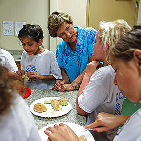 Photo of children in a cooking class - The Foundation was looking for a platform with intuitive navigation and mobile access