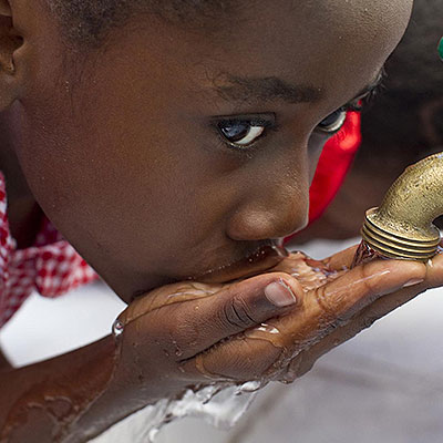 Photo of a child drinking - Re-Solved assisted with system enhancements