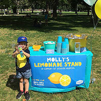 Photo of child at lemonade stand - SmartSimple platform makes an impact on SickKids Foundation