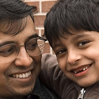 South Asian father and son smiling