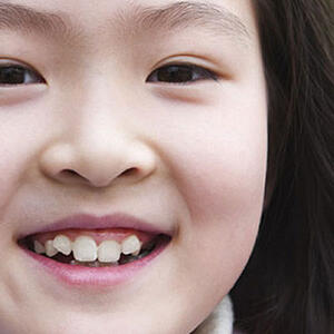 Young girl smiling and looking into camera
