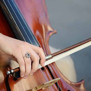 Photo of musician playing cello - Toronto Arts Council and SmartSimple