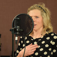 Photo of woman in recording studio - SmartSimple created an interactive mapping feature for Toronto Arts Council