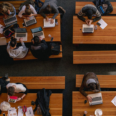 Photo of student studying together - SmartSimple platform has more functionalities