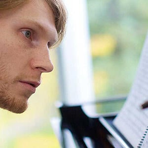 Photo of a music student - SmartSimple system integrates with financial software