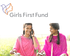 Two South Asian girls on bicycles