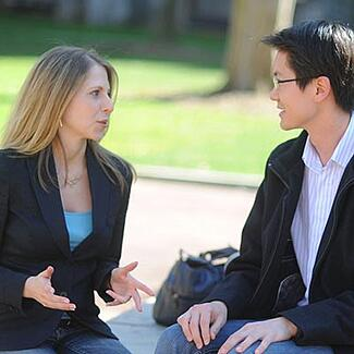 A man and woman in discussion