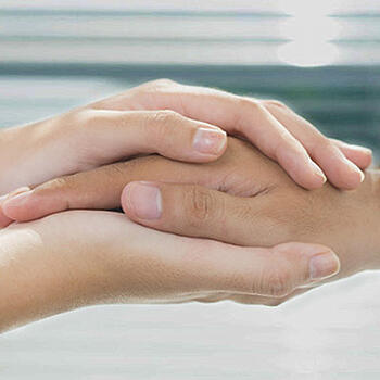 Close up of hands holding hand