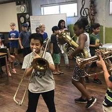 Children musicians rehearsing together