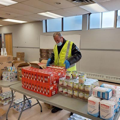 A man prepares food for communities in need.