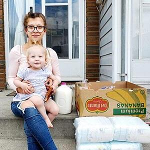 Mom and baby receives donation package.