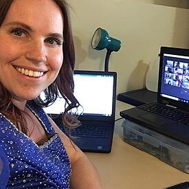 A woman working remotely.