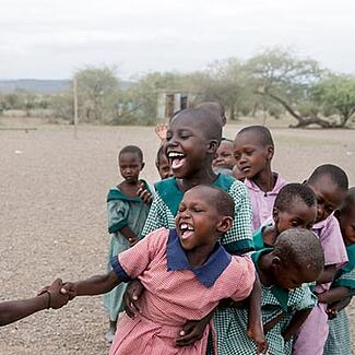A group of African girls playing outside