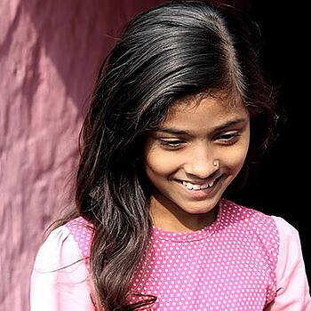 South Asian girl smiling