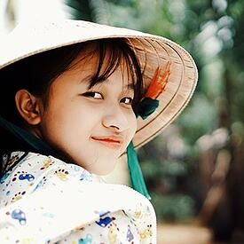 Vietnamese girl in traditional apparel