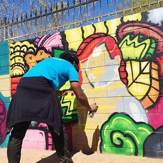 Artist creating graffiti art
