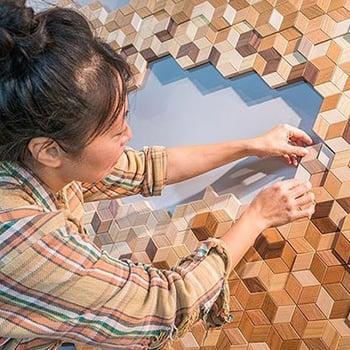 Woman assembling  an artwork