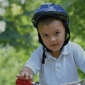 Photo of a boy bicycling - Saskatchewan Health Research Foundation and SmartSimple