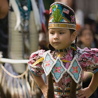 Photo of a First Nations child  - SmartSimple, a service provider of a true all-in-one solution