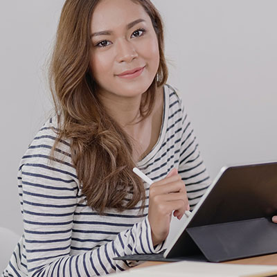 A grantmaker working remotely on her tablet