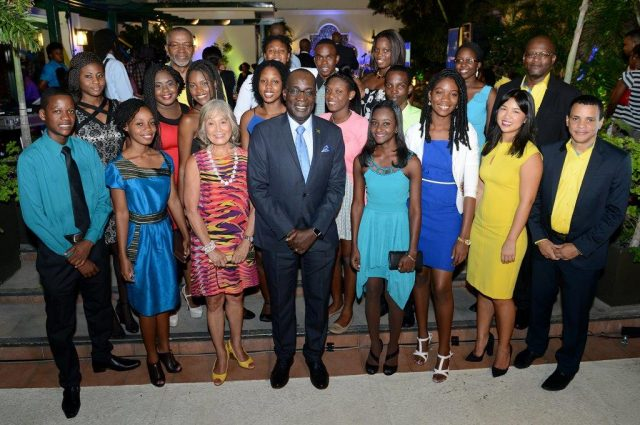 Minister of Education, Youth and Information, Senator Ruel Reid (centre), shares a photo opportunity with 2016 awardees of the National Commercial Bank (NCB) Foundation's scholarships and grants, at a ceremony held recently at The Courtleigh Hotel & Suites in New Kingston .
