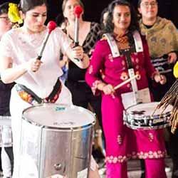 Women drummers performing
